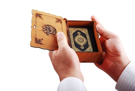 kur'an: Koran, islam holy book hold by male hands