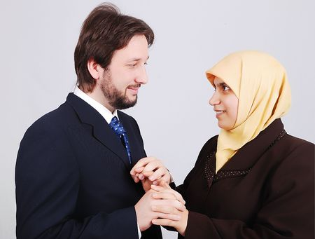 Young muslim couple looking at each other photo