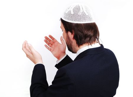 spiritualism: Young male muslim is praying and asking God