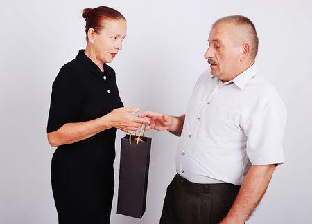Senior couple in white isolated background photo