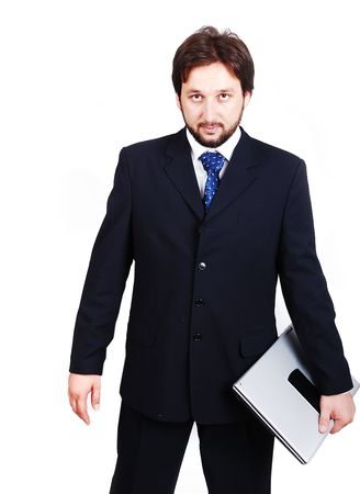 A young attractive male in suit with laptop photo