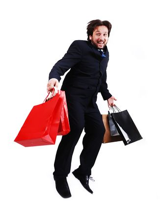 Young attractive bussinesman with shopping jumping photo