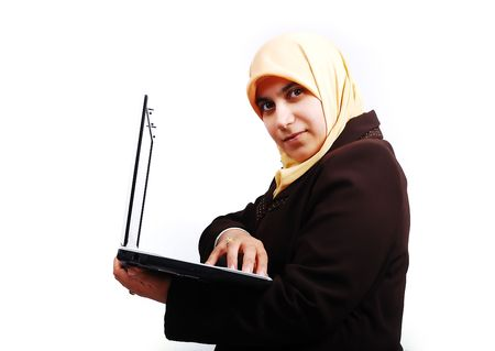 woman handle success: Young muslim female in traditional clothes with laptop