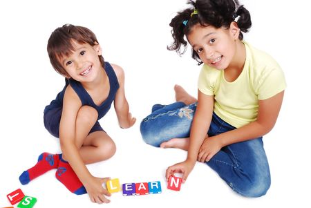 Children playing with cubes in white isolated space photo