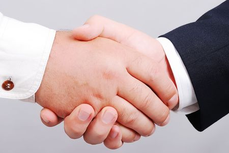 Two white male hands shaking Stock Photo - 5338485
