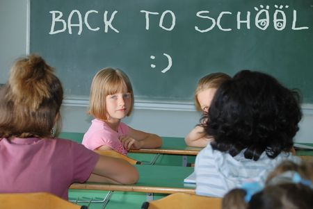 Classroom at school and text on green board photo