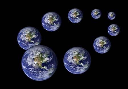Multiplied earth in various sizes in black photo
