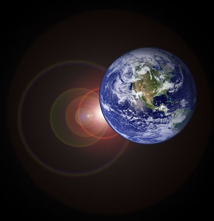 Planet earth with sunlight in space photo