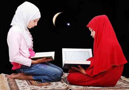 islamic pray: Two muslim girls reading Koran Stock Photo