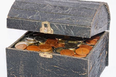 Many coins in one old chest isolated photo
