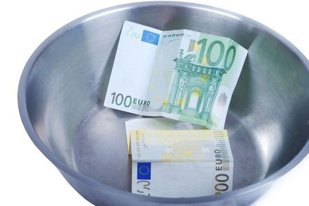 Money in dish prepared for cooking photo