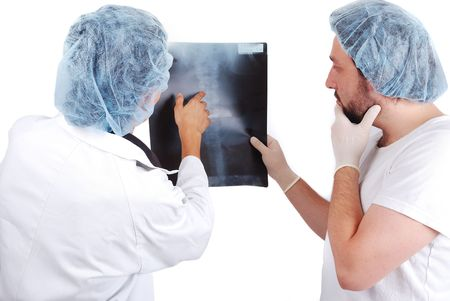 outpatient: Two male doctors looking at scan image