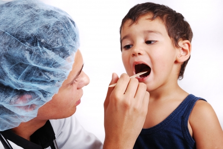 Young male doctor is taking care of little cute kid Stock Photo