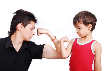 comparison: Young male model is showing muscles to little boy