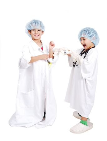 Two very cute children in white hospital clothes Stock Photo - 5411563