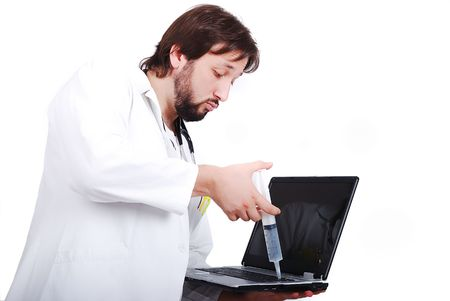 Young male doctor is taking care of laptop photo