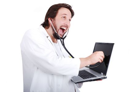 Young male doctor is taking care of laptop Stock Photo - 5411689