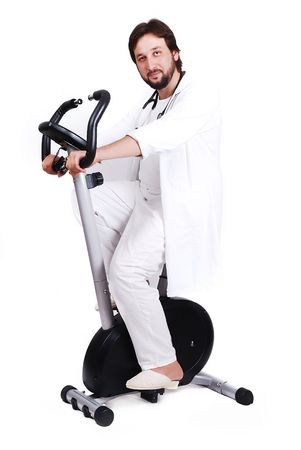 Young male doctor is riding sport bicycle Stock Photo - 5411668
