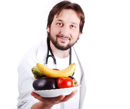 male doctor: Giovane medico di sesso maschile advicing sana alimentazione naturale