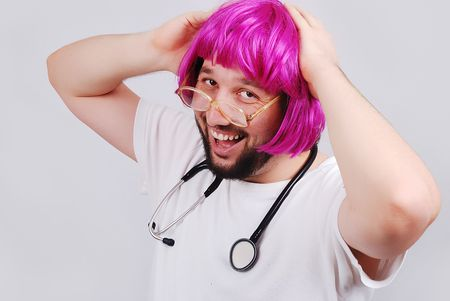 Very funny male doctor with pink hair photo