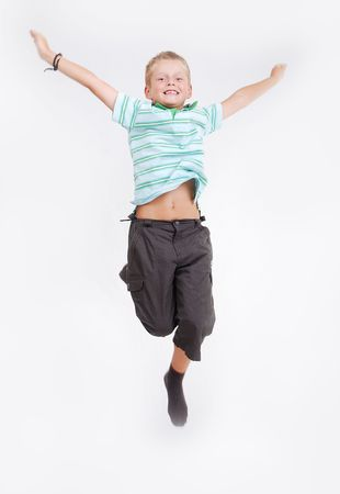 Happy child is jumping high, isolated Stock Photo - 5411671