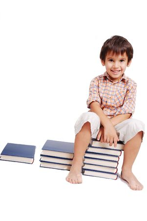 Very cute white kid sitting on books isolated photo