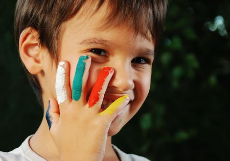 Several colors on children fingers, outdoor photo