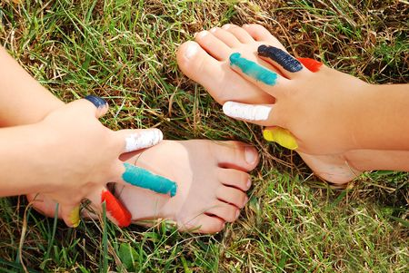 pieds sales: Colors on childs hand and hand on the leg