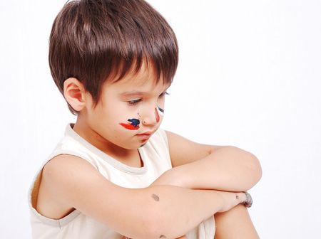 Little cute kid with colors on his face Stock Photo - 5411623