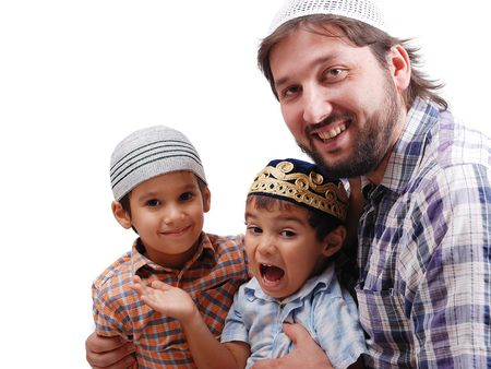 learning pray: Muslim family, father and two boys Stock Photo