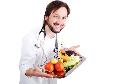 Young male doctor advicing healthy natural food photo