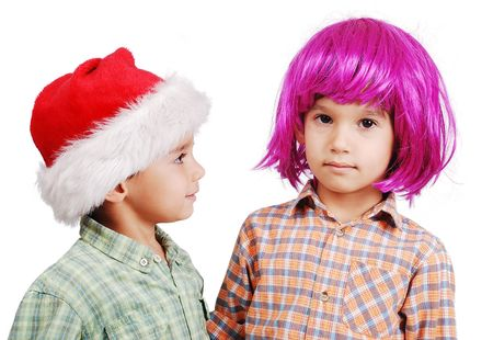 periwig: Funny cute boy with pink periwig on head and santa boy Stock Photo