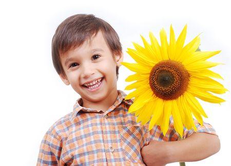 Very cute boy hugging sunflower as friend photo