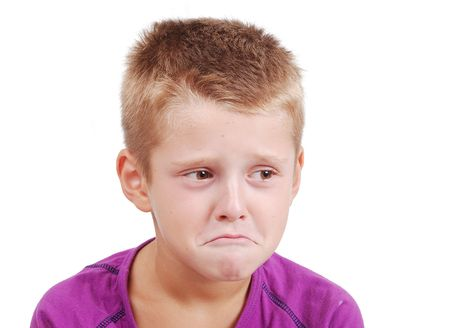 joyless: Very cute little boy with sad expression on face Stock Photo
