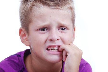 Stress expression on little blond kids face photo