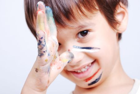 Little cute kid with colors on his face photo