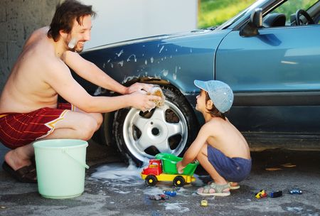 bubble car: Father and little son are playing and washing car