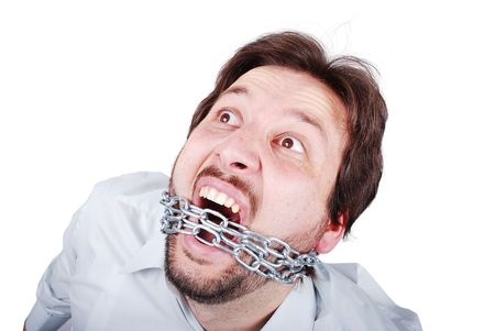 Young male is screaming with chain in mouth Stock Photo - 5483273
