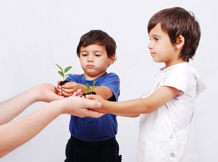 Save our earth, two boys with plant in hands Stock Photo - 5483181
