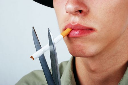 Young male is about to stop smoking photo