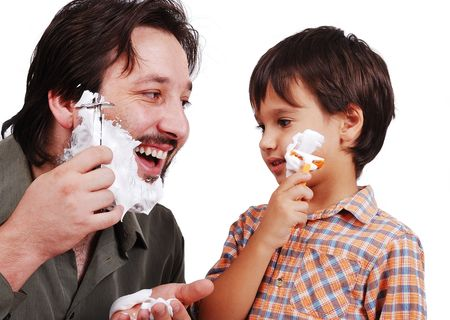 Father is teaching his boy how to shave