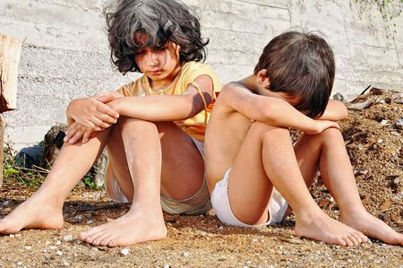 Poverty and poorness on the expression of children photo