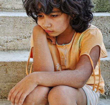 poorness: Poverty and poorness on the expression of children Stock Photo