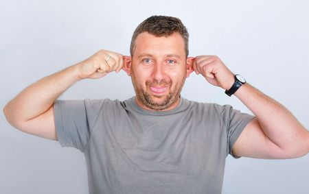Young funny man holding his ears Stock Photo - 5495304