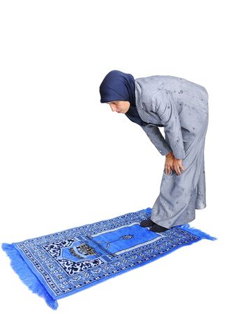 mystery of faith: Young nice muslim female praying on traditional way