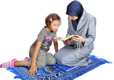 learning pray: Young nice muslim female praying on traditional way