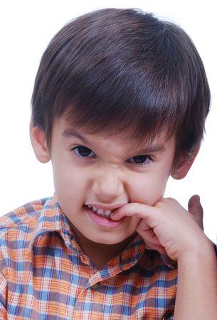 bad habits: Cute boy is bitting fingernails, isolated Stock Photo