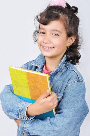 Happy beautiful school girl in studio Stock Photo - 5507967