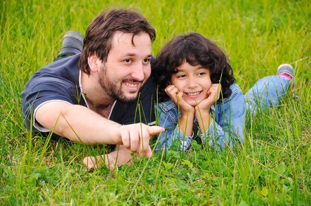 Young father and little cute girl, happiness on meadow Stock Photo - 5555192