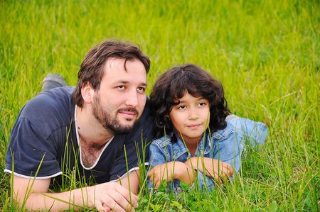Young father and little cute girl, happiness on meadow Stock Photo - 5555147